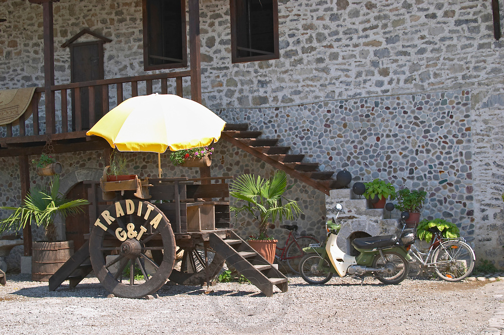 The outside and the entrance of the restaurant. Decorated by an old wooden wheeled cast. Tradita traditional restaurant, Shkodra. Albania, Balkan, Europe.