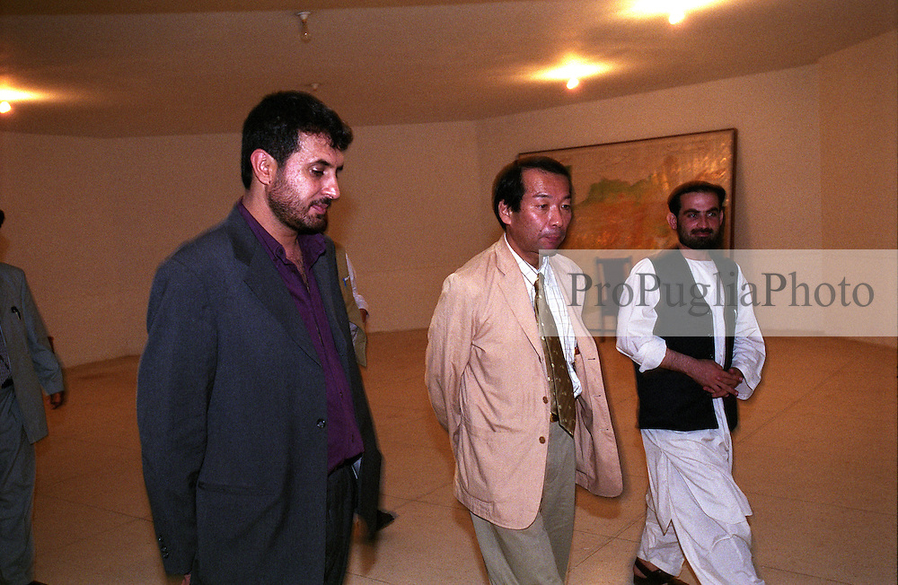 In dark suite the Governor of Kandahar, Haji Asadullah Khalid, and his special guest Nirihiro Okuda - the Ambassador of Japan - walking next to him soon after the official press conference.