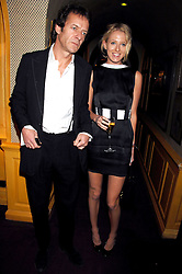 The HON.SOPHIA HESKETH and ROBIE UNIACKE at a dinner hosted by fashion label Issa at Annabel's, Berekely Square, London on 24th April 2007.<br /><br />NON EXCLUSIVE - WORLD RIGHTS