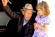 Girl giving advice to painter age 70 and 4.  WesternSprings Illinois USA