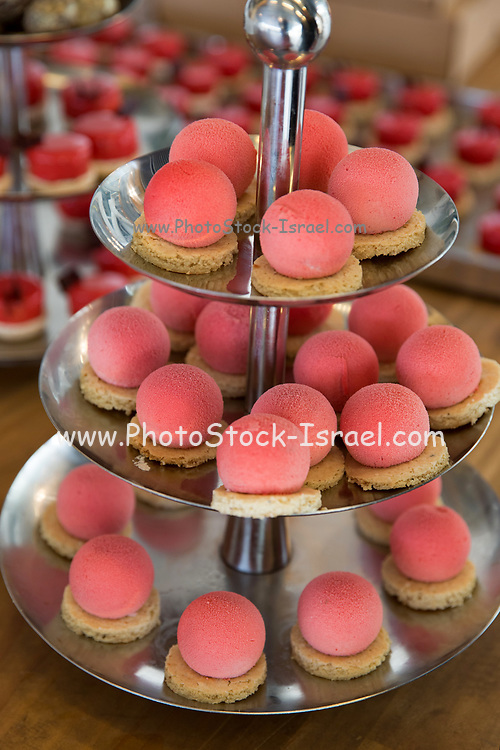 Puffs. Balls of strawberry flavoured mousse on a biscuit base