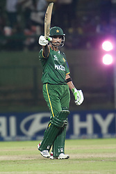 © Licensed to London News Pictures. 25/09/2012. Pakistan batsmen Imran Nazir raises his bat after reaching 50 runs during the T20 Cricket World T20 match between Pakistan Vs Bangladesh at the Pallekele International Stadium Cricket Stadium, Pallekele. Photo credit : Asanka Brendon Ratnayake/LNP