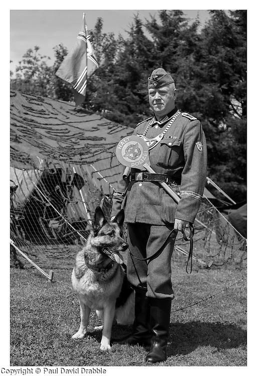 """The more expected face of the Feldgendarmerie as our two Feldgendarmes borrow """"Mishka"""" the German Shepherd for an impromptu photocall   <br /> <br /> 16 June 2013<br /> Image © Paul David Drabble<br /> www.pauldaviddrabble.co.uk"""