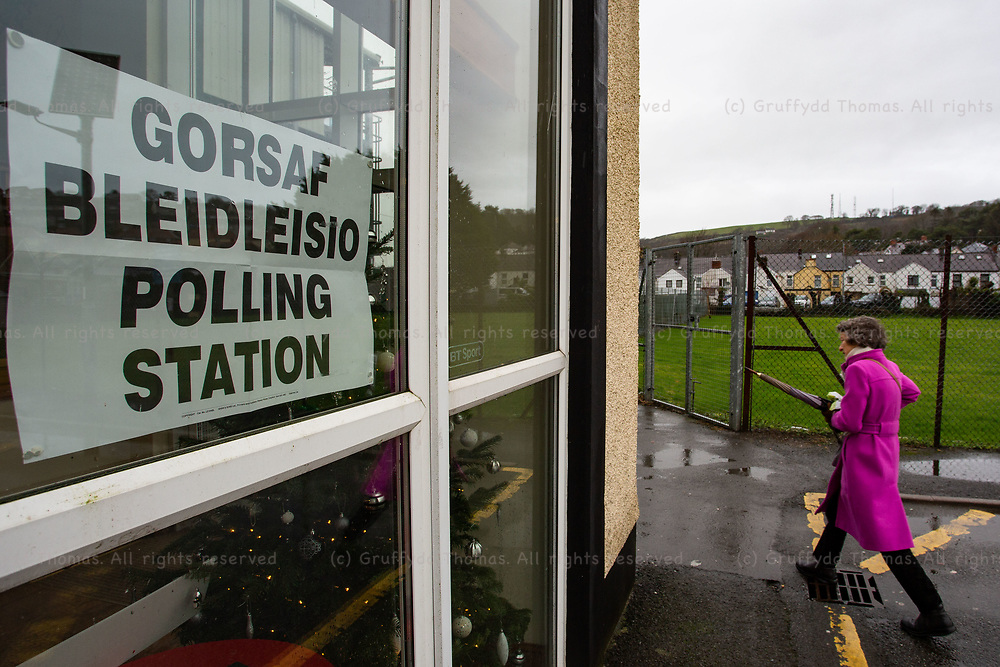 Carmarthen, UK. 12 December, 2019.<br /> A voter arrives at the polling station in Carmarthen Town AFC's clubhouse.<br /> Credit: Gruffydd Ll. Thomas/Alamy Live News