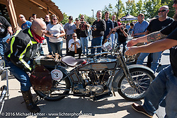 Steve Decosa of New York gets help with his 1915 Harley-Davidson from a spectator at the hosted lunch stop at Powder Keg Harley-Davidson in Mason OH during the Motorcycle Cannonball Race of the Century. Stage-4 from Chillicothe, OH to Bloomington, IN. USA. Tuesday September 13, 2016. Photography ©2016 Michael Lichter.