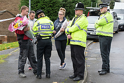 © Licensed to London News Pictures . 23/10/2014 . Penistone , UK . People bring flowers to the scene . A fire in a house on Tennyson Close in Penistone near Barnsley has killed a nine year old boy named as Paul David Sykes and a 44 year old man , named as Darren Sykes . A boy aged 11 is critically ill in hospital . The house is cordoned off by police . Photo credit : Joel Goodman/LNP