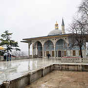 A shot of the outside of the Baghdad Kiosk in the rain. Buildings and decorations in the Enderun, or Inner Palace, at Topkapi Palace. On a peninsula overlooking both the Bosphorus Strait and the Golden Horn, Topkapi Palace was the primary residence of the Ottoman sultans for approximately 400 years (1465–1856) of their 624-year reign over Constantinople and the Ottoman Empire. Today it is one of Istanbul's primary tourist attractions.