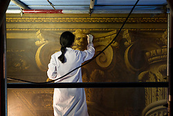 © Licensed to London News Pictures. 03/01/2013. London, UK. Restoration expert Carla Markland works on the the Baroque painted West Wall as part of the renovation works on the Painted Hall at the Old Naval College in Greenwich London today (03/01/12). The restoration, funded by the Heritage Lottery Fund (HLF), is the Painted Hall's 10th since being built in 1742 and is estimated to take around four months. Photo credit: Matt Cetti-Roberts/LNP