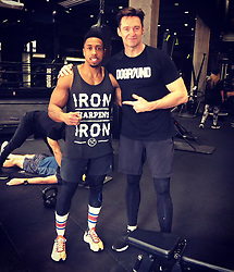 """Hugh Jackman releases a photo on Twitter with the following caption: """"""""With BAR Malik, the performance trainer, for the @nyknicks. He's helping me get ready for the stage. #TheManTheMusicTheShow #DOGPOUND"""""""". Photo Credit: Twitter *** No USA Distribution *** For Editorial Use Only *** Not to be Published in Books or Photo Books ***  Please note: Fees charged by the agency are for the agency's services only, and do not, nor are they intended to, convey to the user any ownership of Copyright or License in the material. The agency does not claim any ownership including but not limited to Copyright or License in the attached material. By publishing this material you expressly agree to indemnify and to hold the agency and its directors, shareholders and employees harmless from any loss, claims, damages, demands, expenses (including legal fees), or any causes of action or allegation against the agency arising out of or connected in any way with publication of the material."""
