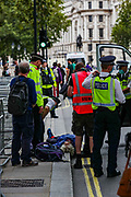 Police arrested a Member of Extinction Rebellion (XR) outside Downing Street in Whitehall, London on Wednesday, Sept 9, 2020 - have been arrested ahead of Prime Minister's Questions (PMQs). Extinction Rebellion has organised a week of action to highlight the climate crisis. They say they are holding the government to account for failing to tackle the issue since declaring 2019 a climate emergency. Boris Johnson dismissed the protests at PMQs, branding the group 'a bunch of crusty left-wing anarchists'.<br /> Environmental nonviolent activists group Extinction Rebellion enters its 9th day of continuous ten days protests to disrupt political institutions throughout peaceful actions swarming central London into a standoff, demanding that central government obeys and delivers Climate Emergency bill. (VXP Photo/ Vudi Xhymshiti)