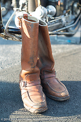 Frank Westfall's boots after crossing the finish line at the end of the first day of the Motorcycle Cannonball Race of the Century. Stage-1 from Atlantic City, NJ to York, PA. USA. Saturday September 10, 2016. Photography ©2016 Michael Lichter.