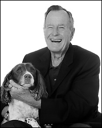 """Picture Former President George H.W. Bush from the book """"Top Dogs and Their Pets"""" depicts a variety of famous people photographed with their animal companions in November 2, 2009 . Photo by David Woo/Dallas Morning News/TNS/ABACAPRESS.COM"""