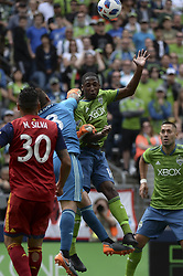 May 26, 2018 - Seattle, Washington, U.S - MLS Soccer 2018: RSL goalie NICK RIMANDO (18) punches the ball away from the Sounders KELVIN LEERDAM (18) as MARCELO SILVA (30) and CLINT DEMPSEY (2) looks on.  Real Salt Lake visited the Seattle Sounders in a MLS match at Century Link Field in Seattle, WA. RSL won the match 1-0. (Credit Image: © Jeff Halstead via ZUMA Wire)