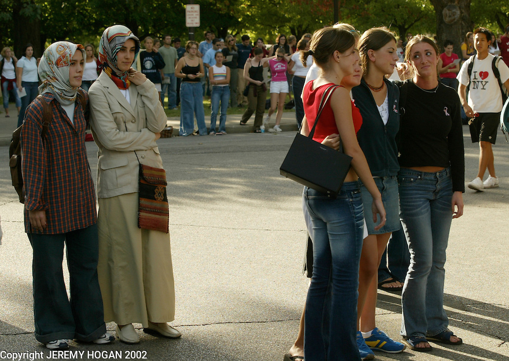 Esra Erdogan and Esma Kaan, left, attend a one year anniversary rememberance ceremony for victims of the Sept. 11 2001 terrorist attack on America September 11, 2002 at Indiana University in Bloomington, Indiana, USA. (Photo by Jeremy Hogan)