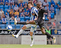 Fotball, <br /> 19.06.2011 , <br /> Tippeligaen  ,<br /> Eliteserien ,<br /> Molde - Sogndal 0-2,<br /> Aker stadion ,  <br /> Magnus wollf eikrem - molde<br /> Ahyee aye elvis - sogndal<br /> <br /> <br /> Foto: Richard brevik , Digitalsport