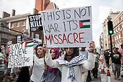 Young women show their support for Gaza and the call to end the siege.<br /> <br /> Tens of thousands of protesters marched in Central London to show their outrage against the Israeli onslaught on Gaza.