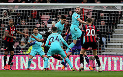 AFC Bournemouth's Nathan Ake (obscured) is fouled in the penalty area by Newcastle United's Federico Fernandez (centre) during the Premier League match at the Vitality Stadium, Bournemouth.
