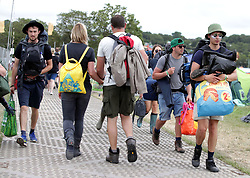 Festivalgoers leaving campsites at Glastonbury Festival, at Worthy Farm in Somerset.