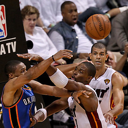 Jun 21, 2012; Miami, FL, USA; Oklahoma City Thunder point guard Russell Westbrook (0) passes the ball off as Miami Heat power forward Chris Bosh (1) and small forward Shane Battier (31) defend during the second quarter in game five in the 2012 NBA Finals at the American Airlines Arena. Mandatory Credit: Derick E. Hingle-US PRESSWIRE