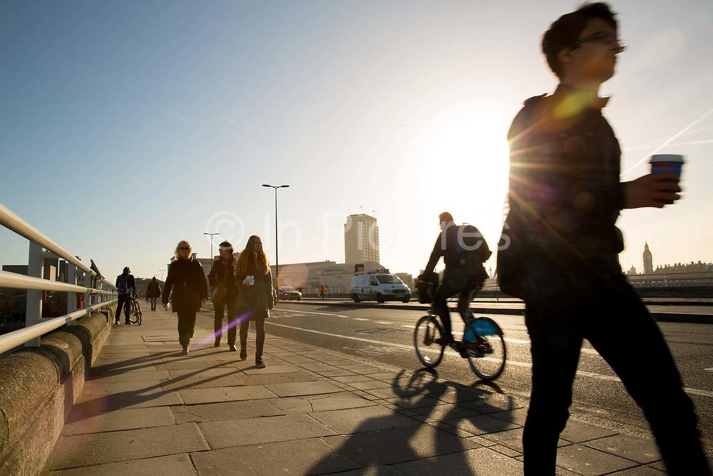 Commuters crossing Waterloo Bridge,  London, UK.