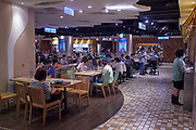 Diners in a the food court next to one of Taipei's subway stations.