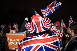 London, UK. 31 January, 2020. Brexit supporters attend a rally in Parliament Square organised by Leave Means Leave on the evening on which the UK leaves the European Union.