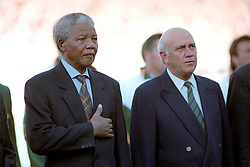 President of South Africa Nelson Mandela (l) with former President F. W. de Klerk (r) during the National Anthems.