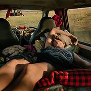 Woman has a nap inside a camping car - camper van.