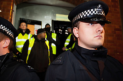 © licensed to London News Pictures. London, UK. 30/01/12. Police line in front of the Earl Street squat. Bailiffs & police move to evict the 'Bank of Ideas' squatted UBS property on sun street and adjacent squat on Earl Street, EC2 after UBS obtained a possession order for the property. Photo credit: Jules Mattsson/LNP