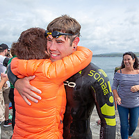 The fastest swimmer, Ryan Shannon, greeted by his mother Kathleen at Liscannor Bay at the Annual Pat Conway and friends Charity Swim from Lahinch to Liscannor Pier in aid of the Burren Chernobyl Project