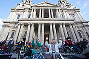 Protesters agree with the speaker using jazz hands at Occupy London OSLX, St Pauls Catherdral, London.