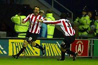 Photo: Chris Brunskill. Wigan Athletic v Sunderland. Coca-Cola Championship. 05/04/2005. Sunderland's goalscorer Marcus Stewart celebrates with team-mate Julio Arca after scoring the only goal of the game