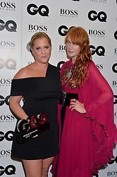 Left to right, AMY SCHUMER and FLORENCE WELCH at the GQ Men of The Year Awards 2016 in association with Hugo Boss held at Tate Modern, London on 6th September 2016.