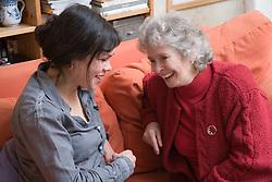 IndependentAge volunteer and older woman laughing together,