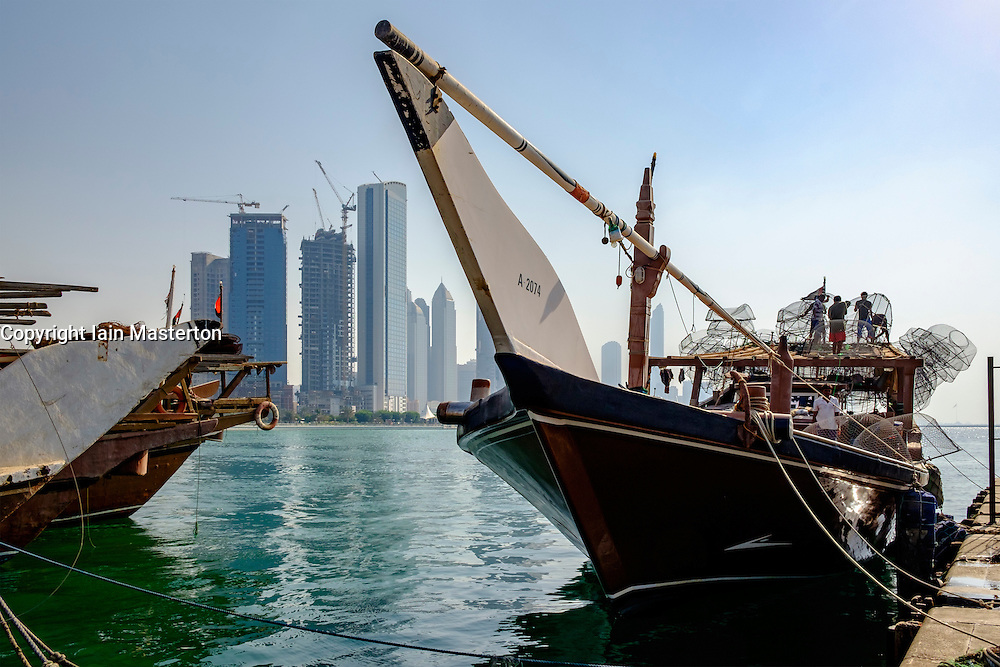 Traditional wooden dhow fishing boat in Abu Dhabi United Arab Emirates