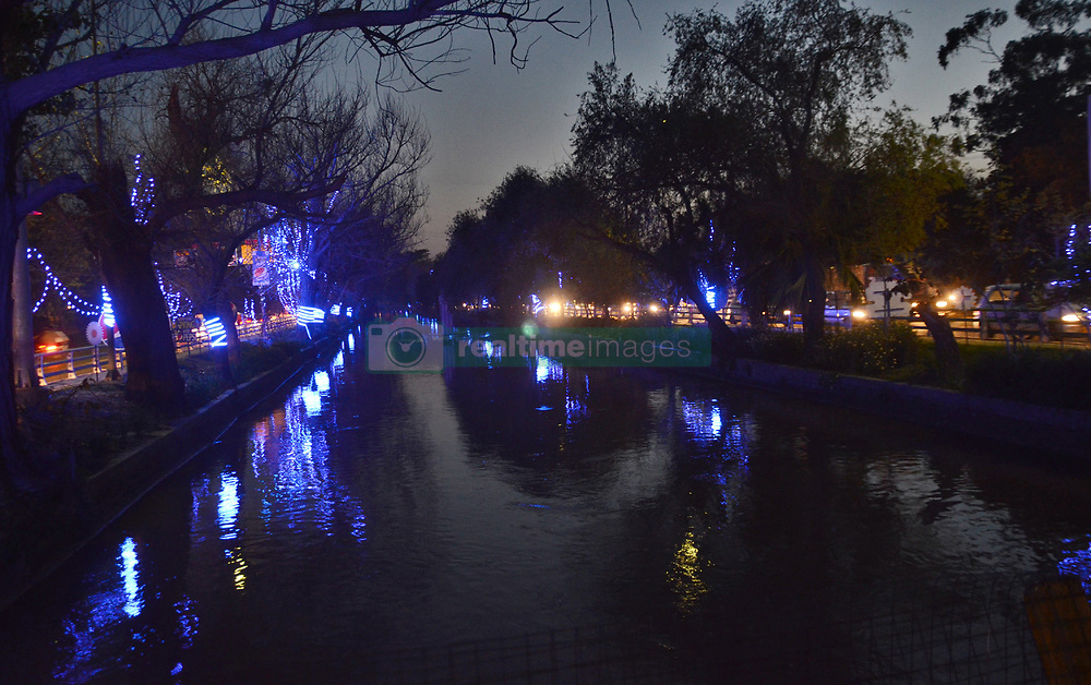 March 22, 2019 - Lahore, Punjab, Pakistan - A stunning attractive and eye-catching view of the lighting at canal preparation for celebrate 23rd march Pakistan. The people of Pakistan celebrate the 23rd of March, every year, with great zeal and enthusiasm, to commemorate the most outstanding achievement of sub-continent Muslims who passed the historic Pakistan Resolution on this day at Minto Park, Lahore in 1940. (Credit Image: © Rana Sajid Hussain/Pacific Press via ZUMA Wire)