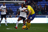 Neil Danns of Bolton Wanderers looks to tackle Conor Coady of Huddersfield Town (r). Skybet football league championship match, Bolton Wanderers v Huddersfield Town at the Macron stadium in Bolton, Lancs on Saturday 29th November 2014.<br /> pic by Chris Stading, Andrew Orchard sports photography.