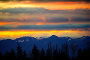 The Cascade Mountains loom in front of a winter sunrise, as seen from SeaTac. (Mike Siegel / The Seattle Times)