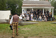 A photographer wearing period dress prepares to take a picture the 124th New York State Volunteers and their families during a Civil War reenactment at the Orange County Farmers Museum on Sept. 23, 2006.