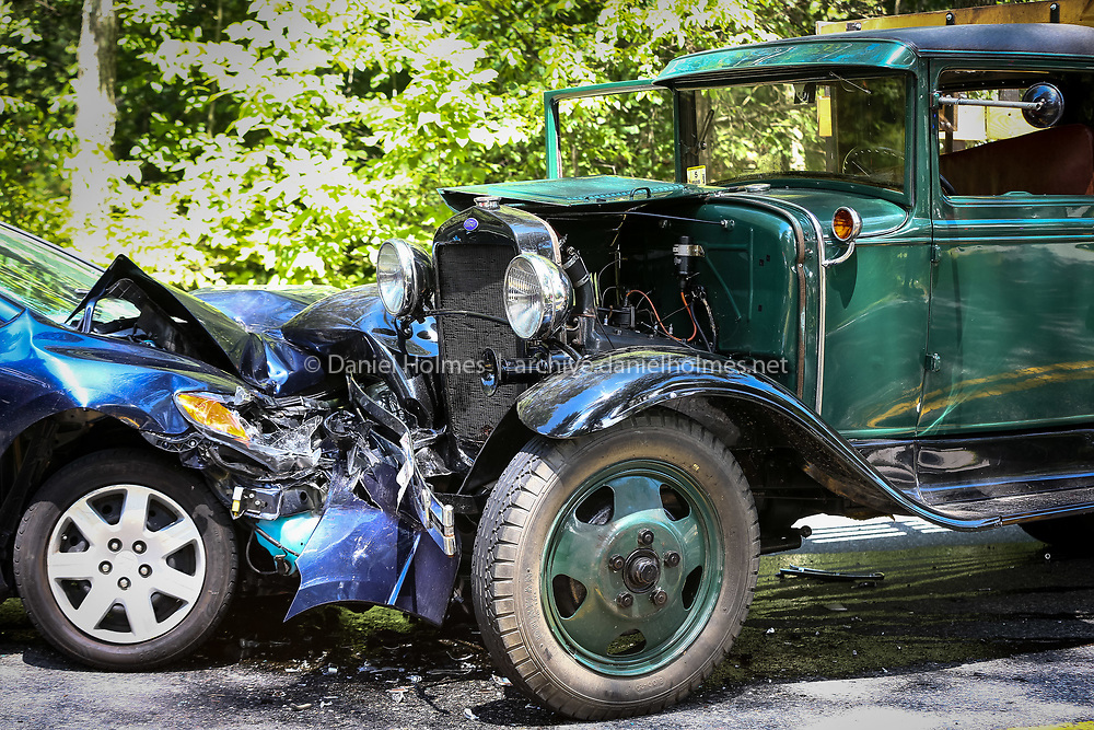 (7/9/14, HOLLISTON, MA) Two of the vehicles, one an antique truck, involved in a three car crash at 2165 Washington Street in Holliston around 11:30 a.m. on Wednesday. According to Holliston Fire Chief Michael Cassidy, four people were transported with injuries including three to area hospitals and one was taken by helicopter to a trauma center. Daily News and Wicked Local Photo/Dan Holmes