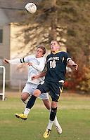 Hopkinton's Brooks Wood and Bow's Josh Faber go for a head ball during NHIAA Division III soccer Monday afternoon.  (Karen Bobotas/for the Concord Monitor)