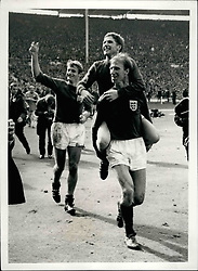 Jul. 07, 1966 - World Cup Football ~~~(WC) free lift football: Little Alan ball of England, who run himself into the Wembley ground this afternoon (saturday) playing a great game for his country, is given a free lift round the stadium by teammate Jackie Charlton during after match scenes. Today when England defeated West Germany ~~~ in the World Cup Final. Following is Roger Hunt. (Credit Image: © Keystone Press Agency/Keystone USA via ZUMAPRESS.com)