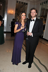 CHARLOTTE COWEN and OLIVER BOLTON at a dinner and dance hosted by Leon Max for the charity Too Many Women in support of Breakthrough Breast Cancer held at Claridges, Brook Street, London on 1st December 2011.