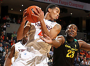 Dec. 17, 2010; Charlottesville, VA, USA; Virginia Cavaliers guard Mustapha Farrakhan (2) grabs a rebound in front of Oregon Ducks forward Jeremy Jacob (23) during the first half of the game at the John Paul Jones Arena. Mandatory Credit: Andrew Shurtleff