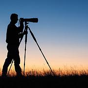 Bill Campbell takes photos at sunset in Badlands National Park, South Dakota, USA