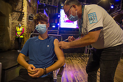 © Licensed to London News Pictures.  08/08/2021. London, UK. Jacob, 16, gets his dose of Pfizer in the nightclub Heaven in central London which host vaccination centre. Visitors will be able to get their first dose of Pfizer. Also, there will also be small numbers of AstraZeneca doses available for those due their second jab.  Photo credit: Marcin Nowak/LNP