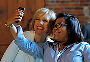 A local small business attendee poses for a selfie with marketing expert Mari Smith at Facebook's Boost your Business Nashville event held at Marathon Music Works on Thursday, Aug. 27, 2015, in Nashville, Tenn. Smith met one-on-one with attendees to offer advice on growing their business's. (Photo by Wade Payne/Invision for Facebook/AP Images)