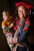 portrait of Sa Mei & her grandson, at village Giang ta chai of the Red Dao hill tribe people outside of Sapa, Northern hill tribe areas, Vietnam