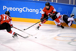 PYEONGCHANG, Feb. 10, 2018  Shannon Sigrist (C) of Switzerland vies for the puck against the unified team of the Democratic People's Republic of Korea (DPRK) and South Korea during their preliminary match of women's ice hockey at the Pyeongchang 2018 Winter Olympic Games at the Kwandong Hockey Centre in Gangneung, South Korea, on Feb. 10, 2018. (Credit Image: © Wang Song/Xinhua via ZUMA Wire)