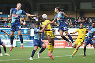 Oxford United striker Jonathan Obika (20) heads the ball  under pressure during the EFL Sky Bet League 1 match between Wycombe Wanderers and Oxford United at Adams Park, High Wycombe, England on 15 September 2018.